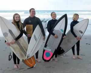 South Coast Boardriders surfers Anika Ayson (14), Duan Reardon, Tash Civil and Luke Rogers (13)...