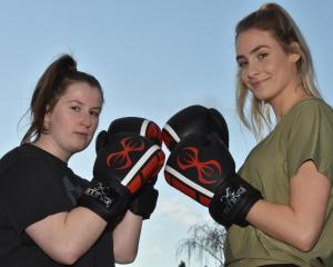 Caitlin Barlow-Groome (left) is facing  Natalie Waller in the first Otago University Students'...