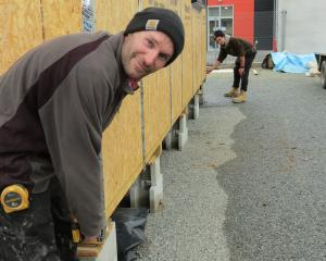Breen Construction builders Andrew McGregor (left), of Alexandra, and apprentice Anton Hood, of...