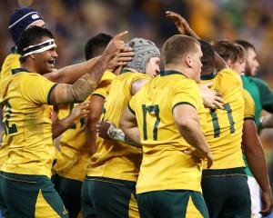 David Pocock of the Wallabies celebrates with his team mates after scoring a try. Photo: Getty...