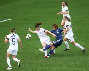 Mina Tanaka of Japan strikes against a lacklustre Football Ferns defence. Photo: Getty Images