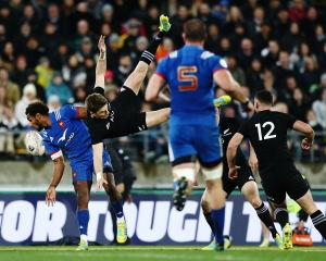 Ben Fall and Beauden Barrett collide as the compete for the ball. Barrett landed heavily on his...