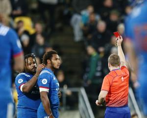 Referee Angus Gardner gives Ben Fall the red card after dangerous play. Photo: Getty Images