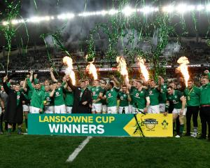 Ireland celebrate with the Landsdowne Cup after defeating Australia in the third test in Sydney...