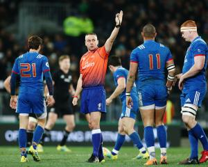 Referee John Lacey makes a call during the International Test match between the New Zealand All...