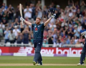 Jonny Bairstow celebrates his century during England's record-breaking ODI innings. Photo: Getty...