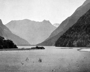 Lake Ada opens up a magnificent scene of splendour from the Milford Sound Track. - Otago Witness,...