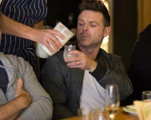 Geoff Scott serves chef Ben Bayly Pamu deer milk at a tasting event in Auckland. Photo: Lance...