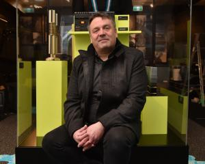 The Chills frontman Martin Phillipps sits amid band memorabilia, including the jumper he wore in...