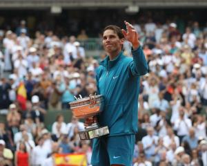 Rafael Nadal with the French Open trophy after winning the final. Photo: Getty Images