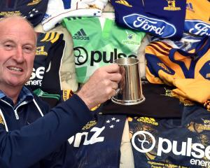 Former Highlanders baggage man Neville Ives with some of the jerseys he has dealt with over the...