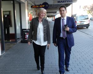 National Party leader Simon Bridges wanders along Thames St in Oamaru with Waitaki MP Jacqui Dean...