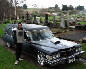 Oamaru's John McLay at Oamaru Old Cemetery with his 1974 Cadillac hearse. PHOTO: DANIEL BIRCHFIELD