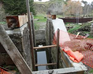 The 4m-deep pit the historic Phoenix Mill water wheel, pictured in the background, will be...