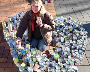 Presbyterian Support practice manager Deb Gelling with cans of food for Octacan in the Octagon on...