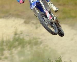Palmerston motocross rider Courtney Duncan flies through the air while training at Titri Park,...