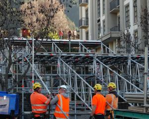 Contractors erect scaffolding on Brecon St yesterday in preparation for tonight's evening's Rail...