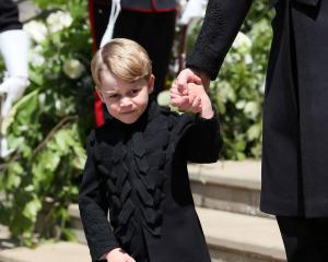 Prince George on the steps of St George's Chapel in Windsor Castle after the wedding of Prince...
