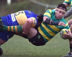 Green Island prop Peter Mirrielees is tackled by Taieri prop Kieran O'Sullivan at Miller Park on...
