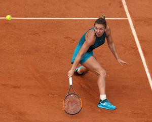 Simona Halep plays a backhand during her French Open quarterfinal this morning. Photo: Getty Images