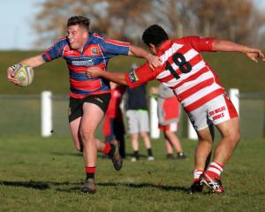 Owaka's Caleb Dempster wrong-foots the defence of Clutha's Joe Laban during a South Otago premier...