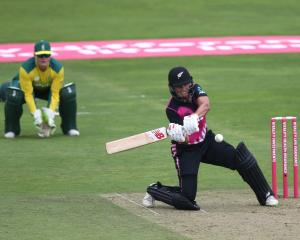 Suzie Bates prepares to smash the ball down the leg side during his century for New Zealand...