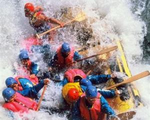 The Original White Water Rafting Company taking a group of rafters through the Mother-in-Law...