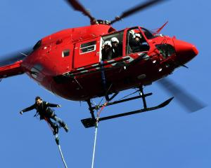 Using a cord he made himself, AJ Hackett Bungy employee Quinn Gardiner jumps from a Heli Otago...