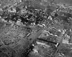 A view from 500 feet of the war devastation at Ypres, Flanders, a city once famous for its linens...