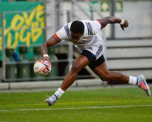 Carlin Isles in action for the US against New Zealand in the Canadian leg of the world sevens...