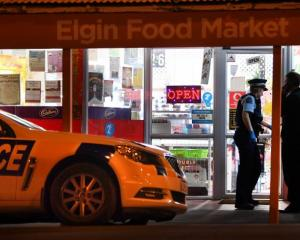 Police at the Elgin Food Market on Monday night. Photo: Stephen Jaquiery