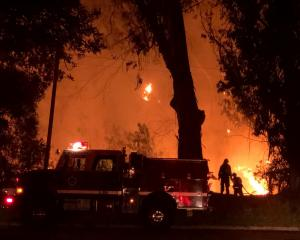 Firefighters work at the site of a wildfire in Goleta. Photo: Mike Eliason/Santa Barbara County...