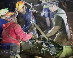 Rescue personnel worked to free the boys and their coach from the Tham Luang cave complex. Photo:...