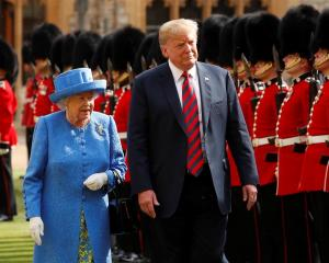 US President Donald Trump and Queen Elizabeth inspect the Coldstream Guards during a visit to...