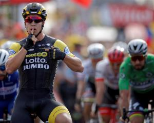Dylan Groenewegen crosses the line to win Stage 6 of this year's  Tour de France. Photo: Reuters