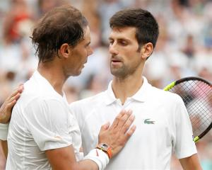 Rafal Nadal (L) congratulates Novak Djokovic after the match. Photo: Reuters