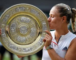 Angelique Kerber kisses the trophy after her win in the final at Wimbledon. Photo: Reuters