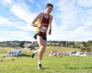 Daniel Balchin climbs a hill during his win at the Otago cross-country championships at the...