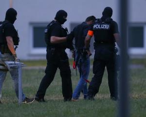 Twenty-year-old Iraqi Ali B. is escorted by special police upon his arrival in Wiesbaden. Photo:...