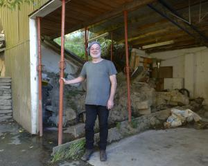 There is still detritus from the landslip in Gordon Carter's St Clair garage, a year after the...