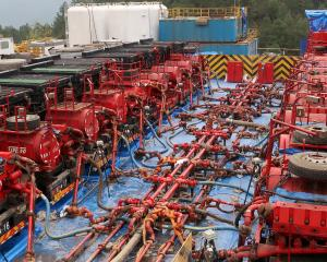 Fracking trucks at work at a Sinopec shale gas well in Nanchuan, China. Photo: Reuters