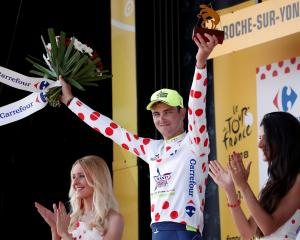 Dion Smith celebrates with the polka-dot jersey after the latest leg of the Tour de France. Photo...