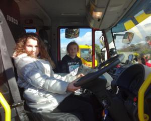 Taking the wheel at the Waikouaiti Volunteer Fire Brigade open day yesterday are Maia  Jenkins ...