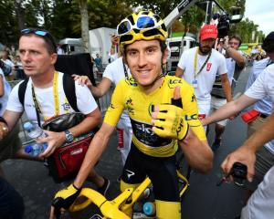 Geraint Thomas celebrates after winning the Tour de France. Photo: Getty Images