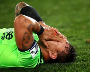 A dejected Ash Dixon lets it all sink in after the final whistle. Photo: Getty Images