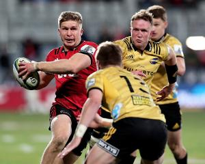 Jack Goodhue breaks past Gareth Evans during an impressive semifinal performance. Photo: Getty...
