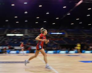 Jane Watson of the Tactix warms up prior to the ANZ Netball Championship match between Mainland...