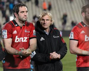 Crusaders coach Scott Robertson (C) and captain Sam Whitelock (L) after their win against the...