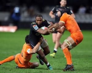 The Sharks' Lukhanyo Am is caught by the Jaguares defence. Photo: Getty