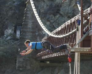 Global wanderer Rhys Lawrey tries bungy-jumping at the Kawarau Bridge bungy site after reaching...